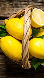 Fotos Zitrone Bretter Weidenkorb Lebensmittel