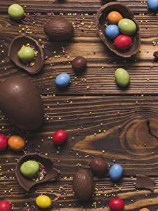 Papéis de parede Páscoa Chocolate Bala (doce) Confecção Tábuas de madeira Ovo Alimentos