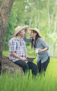 Images Asian Man Two Hat Sitting Grass Brunette girl Girls
