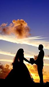 Pictures Sunrises and sunsets Sky Man Lovers Clouds Silhouettes Two Grooms Bride