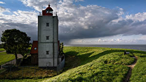 Bilder Niederlande Küste Leuchtturm Himmel Gras Wolke Oosterdijk Natur