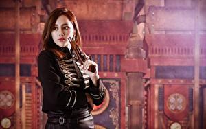 Bilder Pistole Asiatische Braunhaarige Blick Uniform Unscharfer Hintergrund Mädchens