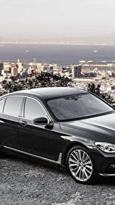 Pictures BMW Black Metallic Sedan G11 7-Series automobile
