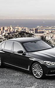 Hintergrundbilder BMW Schwarz Metallisch Limousine G11 7-Series Autos