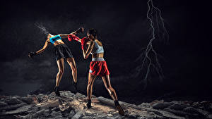 Bilder Boxen 2 Bein Hand Blitze Shorts Schlägerei Schlagen junge Frauen Sport