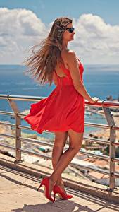 Photo Spain Brown haired Glasses Gown Stilettos Red Fence Canary Islands Windy Gran Canaria young woman