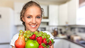 Pictures Fruit Strawberry Pears Apples Grapes Face Smile young woman