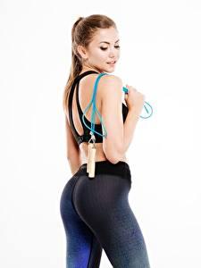 Bilder Fitness Braune Haare Posiert Weißer hintergrund Gesäß Schöne  sportliches Mädchens