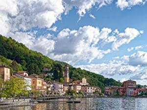 Bilder See Schiffsanleger Gebäude Italien Himmel Porto Ceresio, lake Lugano, province of Varese Städte