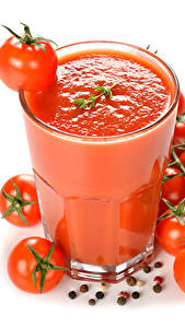 Bilder Fruchtsaft Tomate Weißer hintergrund Trinkglas Lebensmittel