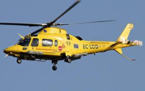 Bilder Hubschrauber Gelb Flug Agusta A.109E Power