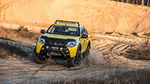 Bilder Mitsubishi Gelb Metallisch Pick-up Vorne 2016 L200 Monster Concept Autos