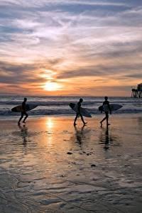 Fotos Vereinigte Staaten Sonnenaufgänge und Sonnenuntergänge Surfen Ozean Strand Drei 3 Montana, Huntington Beach