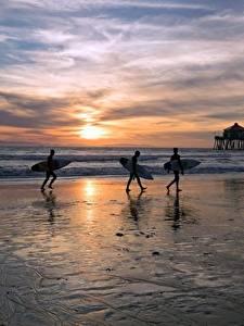 Fotos Vereinigte Staaten Sonnenaufgänge und Sonnenuntergänge Surfen Ozean Strand Drei 3 Montana, Huntington Beach Natur
