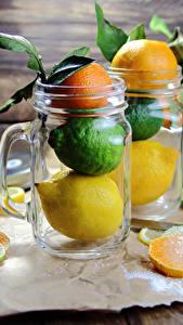 Fotos Zitrusfrüchte Mandarine Zitrone Orange Frucht Limette Becher Bretter Einweckglas Lebensmittel
