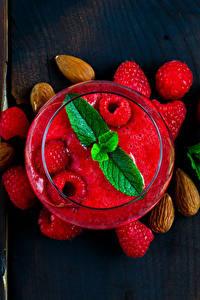 Hintergrundbilder Fruchtsaft Himbeeren Nussfrüchte Trinkglas Von oben Blatt Minzen Lebensmittel