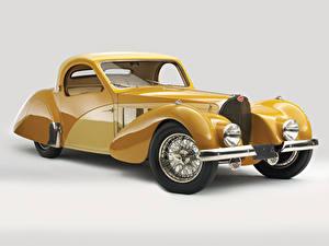 Bilder BUGATTI Antik Grauer Hintergrund Gelb Metallisch 1937 Type 57S Atalante Autos
