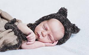 Pictures Baby Sleep Winter hat Hands Children