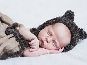 Pictures Baby Sleep Winter hat Hands Children