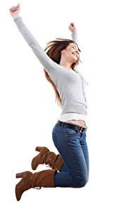 Bilder Weißer hintergrund Braune Haare Glücklich Sprung Jeans Hand Stiefel Mädchens
