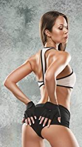 Fotos Fitness Gesäß Hand Handschuh Pose junge frau Sport