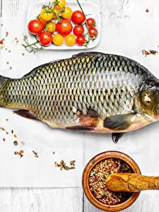 Bilder Meeresfrüchte Fische - Lebensmittel Gewürze Tomate Bretter
