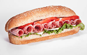 Fotos Fast food Sandwich Brötchen Wurst Gemüse Weißer hintergrund