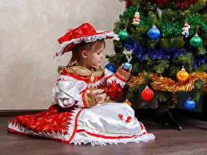 Images Christmas Holidays Christmas tree Little girls Dress Sitting Hat Balls child