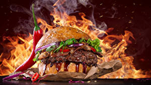 Bilder Fast food Burger Flamme Gemüse Chili Pfeffer