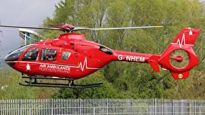 Bilder Hubschrauber Rot Seitlich Flug G-NHEM Eurocopter EC-135-T2