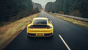 Wallpapers Porsche Roads Yellow Back view Motion 911 Carrera 4S 2019