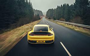 Wallpapers Porsche Roads Yellow Back view Motion 911 Carrera 4S 2019