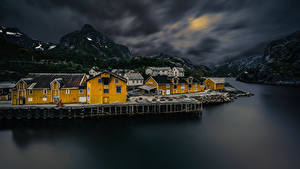 Picture Norway Lofoten Mountain Houses Village Night time Bay Nusfjord Cities