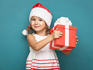 Wallpapers New year Colored background Little girls Winter hat Present Smile Frock Children