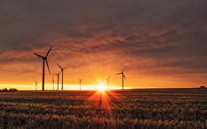 Bilder Landschaftsfotografie Acker Sonnenaufgänge und Sonnenuntergänge Lichtstrahl Sonne Windkraftanlage