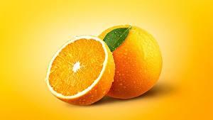Tapety na pulpit Pomarańcza owoc Zbliżenie Kolorowe tło Kropli żywność