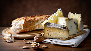 Fotos Käse Brot Nussfrüchte Schneidebrett das Essen