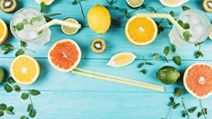 Fotos Zitrusfrüchte Zitrone Grapefruit Essstäbchen Trinkglas Bretter Lebensmittel