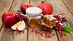 Fotos Honig Äpfel Granatapfel Bretter Einweckglas Getreide das Essen