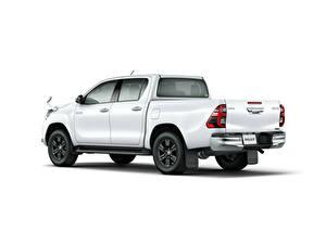 Fotos Toyota Pick-up Weiß Metallisch Weißer hintergrund Hilux Z Double Cab, JP-spec, 2020 auto