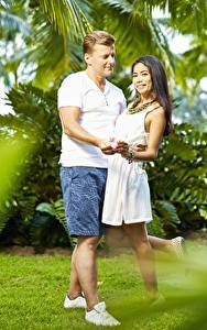 Pictures Asiatic Man Couples in love 2 Smile Shorts Hug Girls