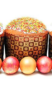 Bilder Feiertage Ostern Kulitsch Backware Weißer hintergrund Ei Drei 3 Lebensmittel