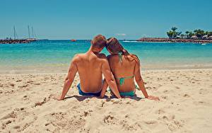 Wallpapers Couples in love Men Sea Beach Sand Back view Two Sitting Human back Rest young woman