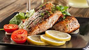 Bilder Fische - Lebensmittel Zitrone Tomate