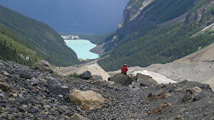 Pictures Canada Lake Stones Mountains Parks Banff Cliff Traveler lake Louise, Rocky Mountains, Alberta Nature