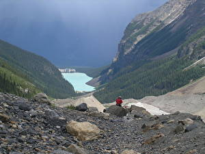 Pictures Canada Lake Stones Mountains Parks Banff Cliff Traveler lake Louise, Rocky Mountains, Alberta Nature