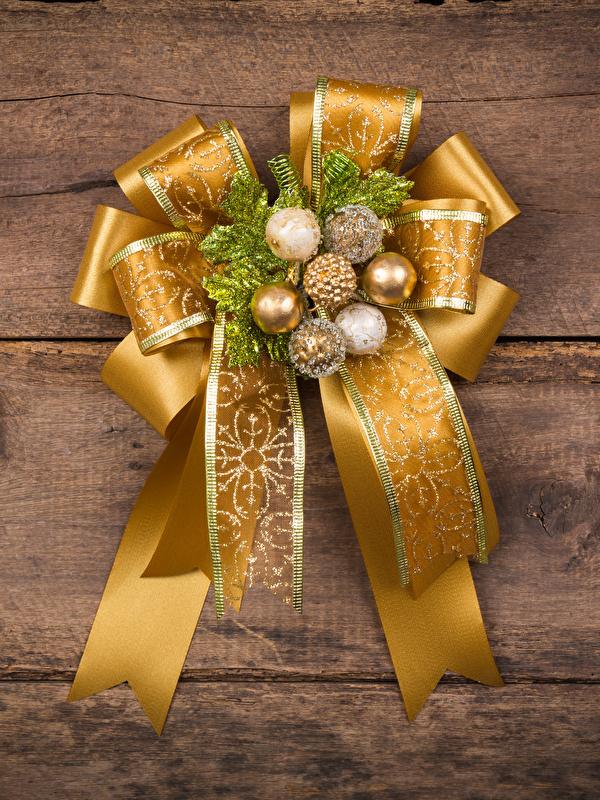 Fotos Neujahr Gold Farbe Kugeln Schleife Design Bretter 600x800