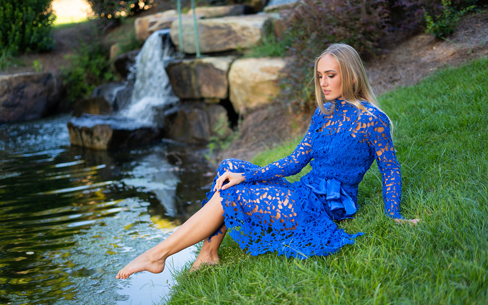 Pictures female Olga Clevenger Grass Sitting Creek Legs Dress Blonde girl 1920x1200 Girls young woman sit brook Creeks Stream Streams gown frock