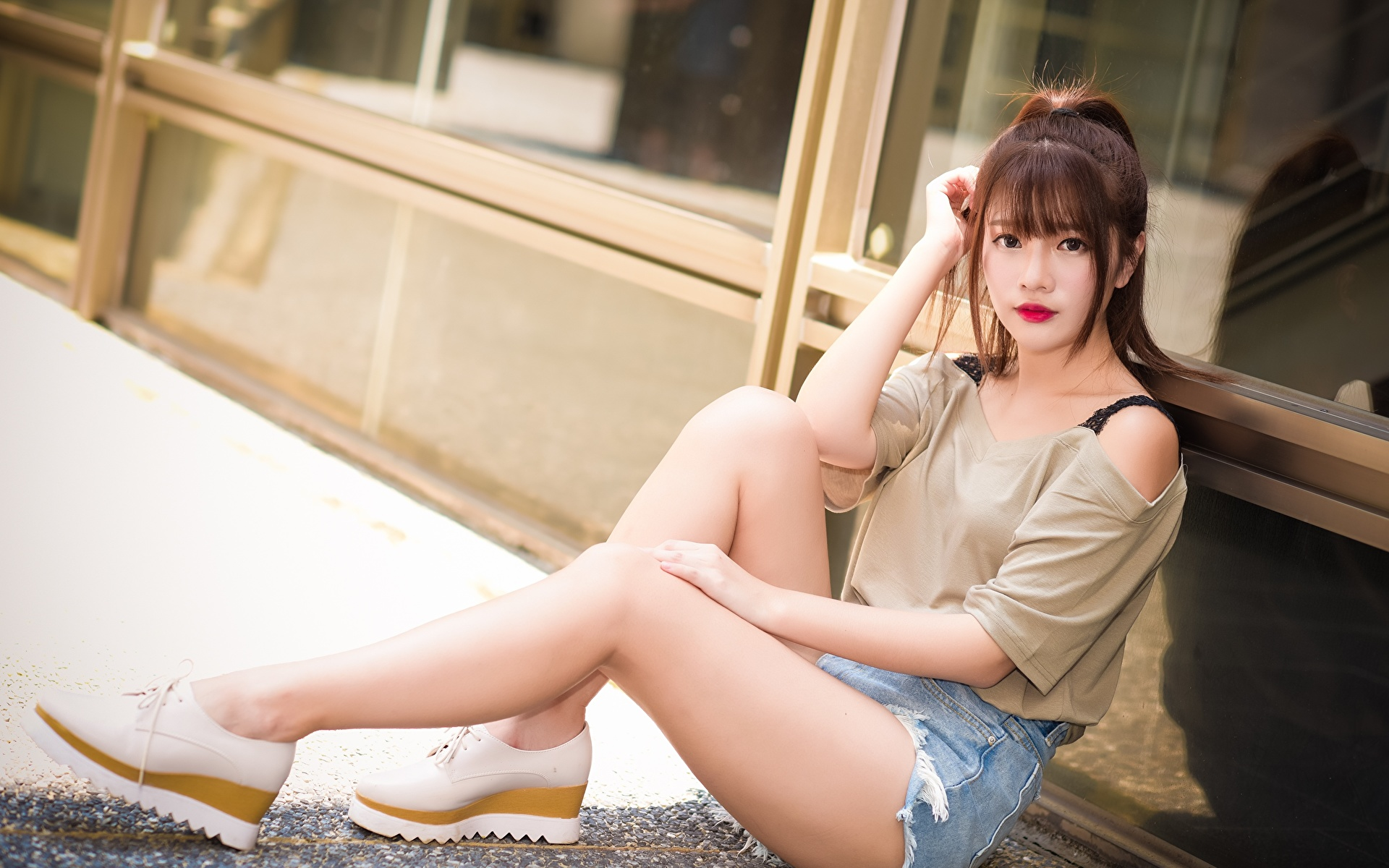 Photos Brown haired Girls Legs Asiatic Hands Shorts Sitting Stilettos 1920x1200 female young woman Asian sit high heels