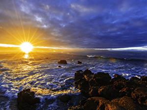 Bilder Meer Küste Sonnenaufgänge und Sonnenuntergänge Himmel Steine Sonne